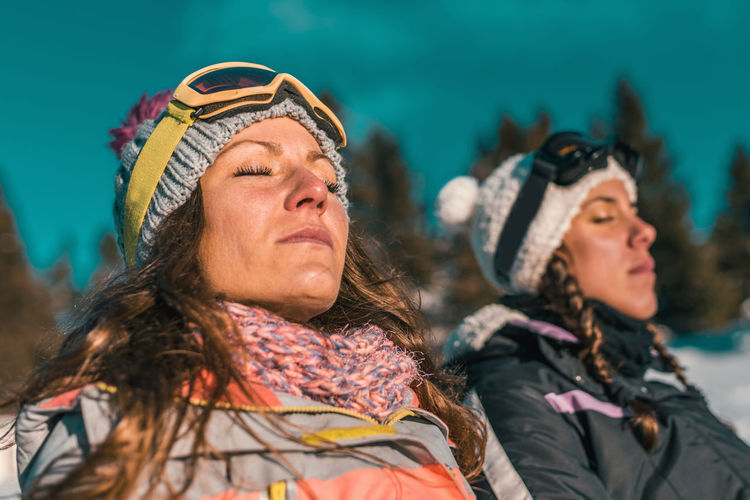 Close-Up Of Women With Closed Eyes In Sunny Day