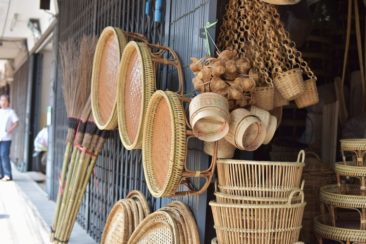 Wicker containers for sale at market stall