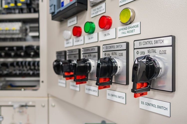 Close-up Communication Connection Container Control Control Panel Electricity  Emergency Equipment Equipment In A Row Indoors  Instrument Of Measurement Machinery No People Push Button Red Security Sign Technology Text