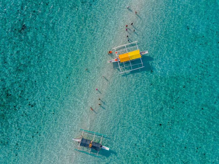 Aerial view of outrigger boats at sea