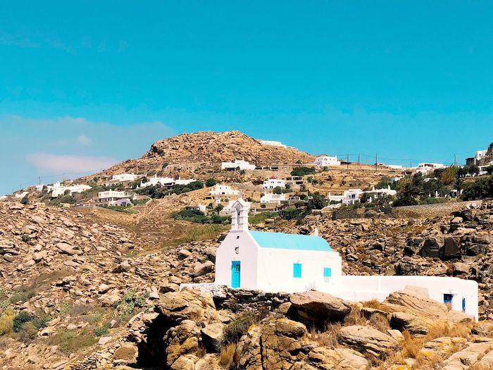 Church On Landscape Against Blue Sky