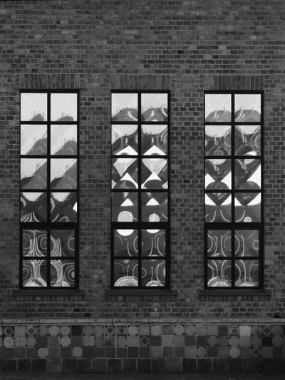 EyeEmNewHere Window Architecture No People Wall - Building Feature Built Structure Glass - Material Building Glass Day Square Shape Side By Side Brick Wall Square Windows Reflection Abstract Architecture Blackandwhite Black And White