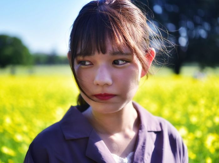Portrait of girl on field
