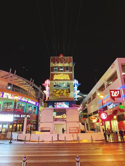 Illuminated city buildings at night