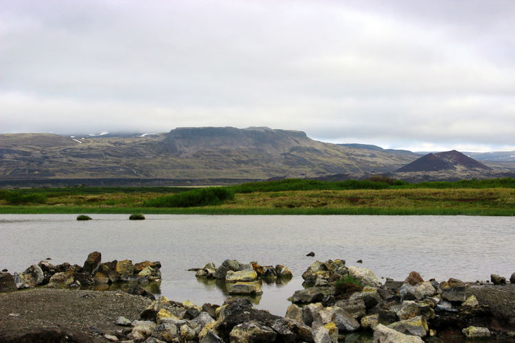 Mountains beyond the Landbrotalaug Hot Spring. Iceland Beauty In Nature Cloud - Sky Day Environment Hot Spring Iceland_collection Landbrotalaug Landscape Mountain Mountain Peak Mountain Range Nature No People Outdoors Rock Rock - Object Scenics - Nature Sky Tranquil Scene Tranquility Water Wilderness
