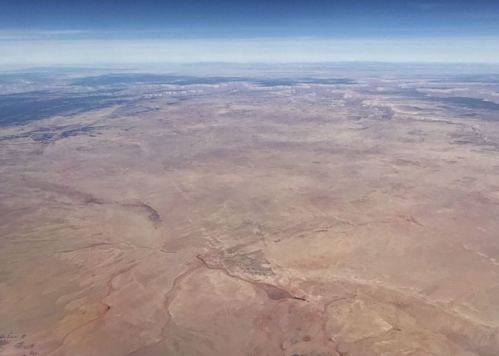 Desert landscape from above. Western USA Desert Desert Colors Desert Rugged Landscape Arid Landscape Aerial View Landscape Nature Scenics Tranquil Scene Beauty In Nature Outdoors Geology Arid Climate Physical Geography Sky Day
