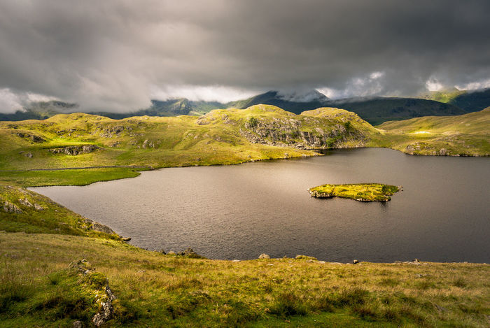 Angle Tarn in the Lake District, UK Angle Tarn Cumbria England UK Lake District Beauty In Nature Cloud - Sky Day Grass Island Lake Landscape Mountain Nature No People Outdoors Scenics Sky Tranquil Scene Tranquility Travel Destinations Tree Water