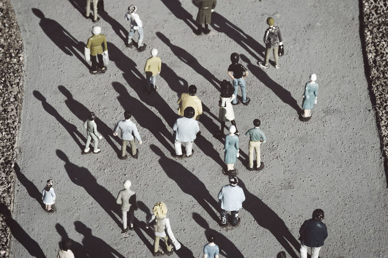 people figurines on the street Crowd Directly Above Elevated View Figurine  Figurines  High Angle View Likeness Medium Group Of People Miniature Overview People Plastic Replica  Shadow Street Sunlight Togetherness Toy