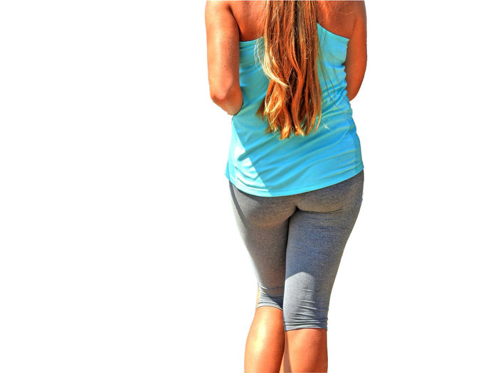 Midsection of woman running against white background