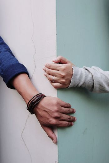 The distance that must be maintained during the covid-19 pandemic. close-up hands couple