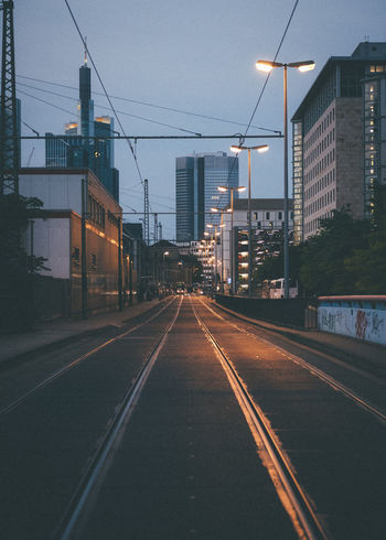 Transportation Architecture Building Exterior Built Structure City Street Road The Way Forward Direction No People Railroad Track Street Light Cable Symbol Sky Building Sign Track Rail Transportation Road Marking Diminishing Perspective Electricity  Outdoors Long