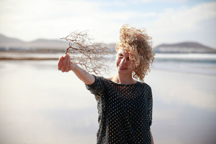 Blonde Girl Blonde Hair Confidence  Curly Hair Front View Girl Hand People Of The Oceans Lanzarote Long Hair Natural Light Portrait Low Tide Mountains Portrait Sea Seaside Shore Twig Waist Up Water Young Adult Young Women Girl Power People And Places Exploring Style Breathing Space Done That. Connected By Travel An Eye For Travel Visual Creativity The Portraitist - 2018 EyeEm Awards International Women's Day 2019