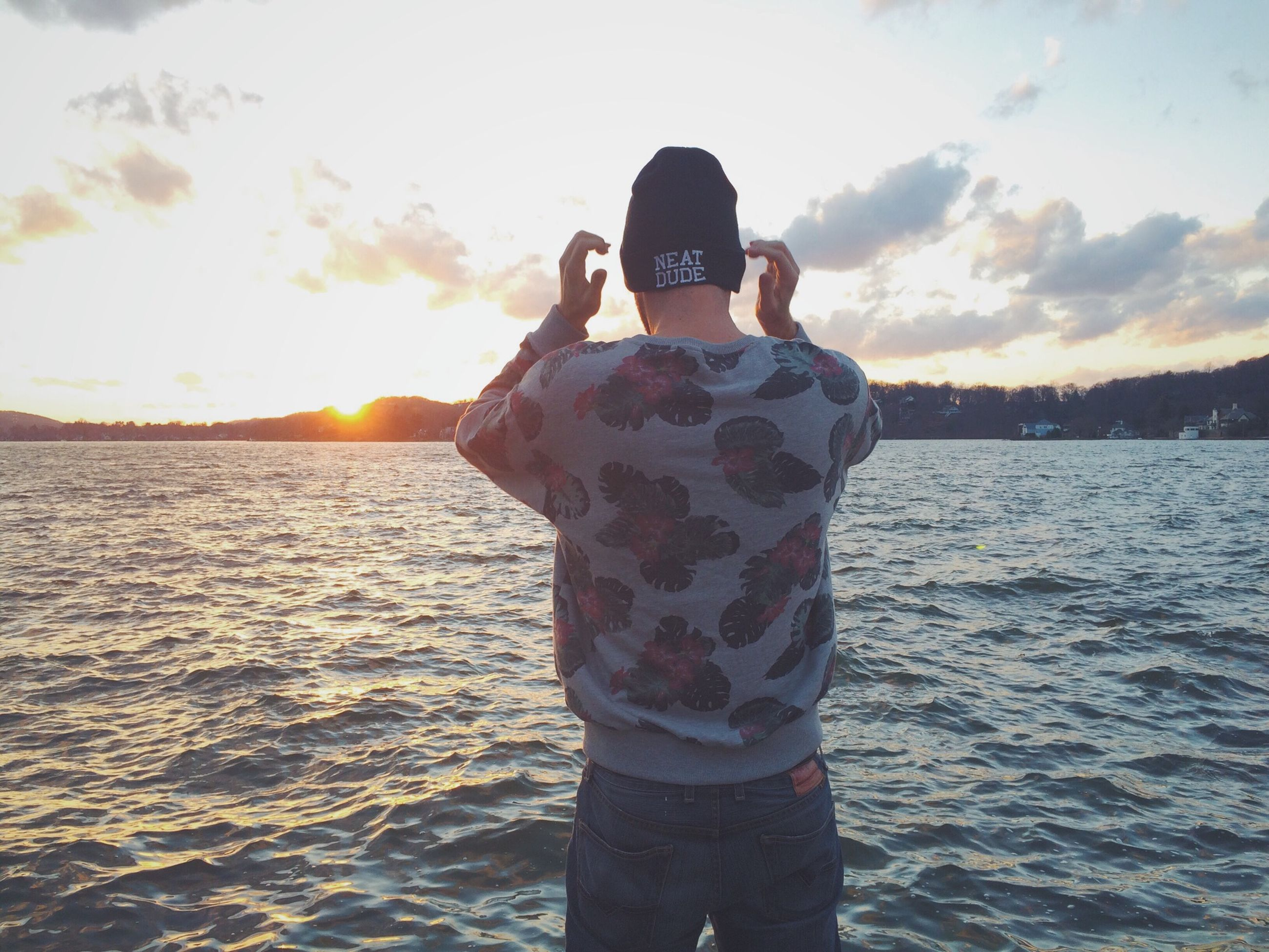 water, sunset, lifestyles, sky, leisure activity, standing, sea, rear view, three quarter length, tranquil scene, scenics, tranquility, beauty in nature, men, nature, cloud - sky, casual clothing, sun