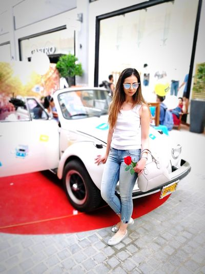 Young Women Portrait Full Length Smiling Cheerful Happiness Looking At Camera Car City Casual Clothing