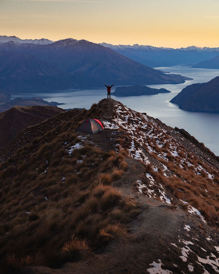 Wanaka Beauty In Nature Cold Temperature Environment Human Arm Land Mountain Mountain Range Nature Non-urban Scene One Person Outdoors Rock Royspeak Scenics - Nature Sky Snow Sunset Tranquil Scene Tranquility Water Winter
