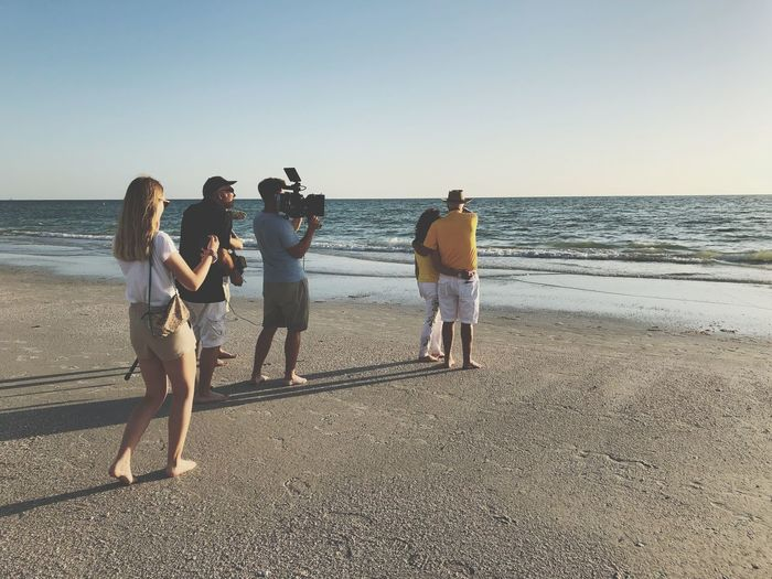 Filmshoot at the Beach Film Industry Shooting Filmproduction EyeEm Selects Beach Sea Water Land Group Of People Sky Horizon Over Water Real People Leisure Activity Togetherness People Clear Sky