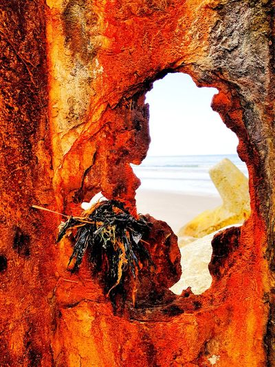 Løkken, Strand Landscape Sand Beach Weathered Metal Rusty Abstract Rust Abstract Photography Taking Photos Taking Pictures The Week on EyeEm Timepaint72 Rock - Object Nature Red Scenics Beauty In Nature Natural Arch Sunset Outdoors Sky Day Sea No People Horizon Over Water