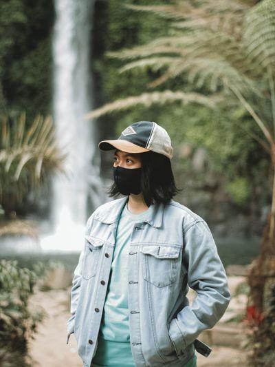 Man wearing hat while standing on land