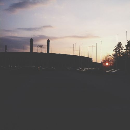 Car on road at sunset