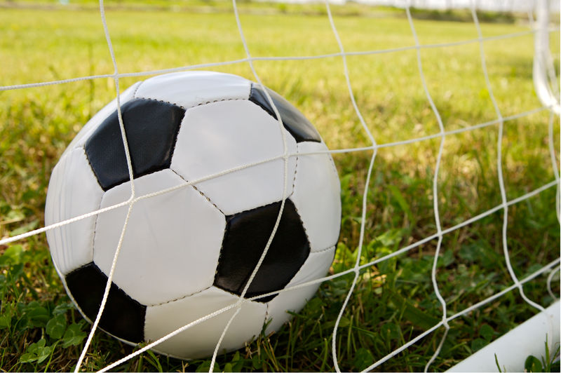 Close-up of soccer ball on grassy field