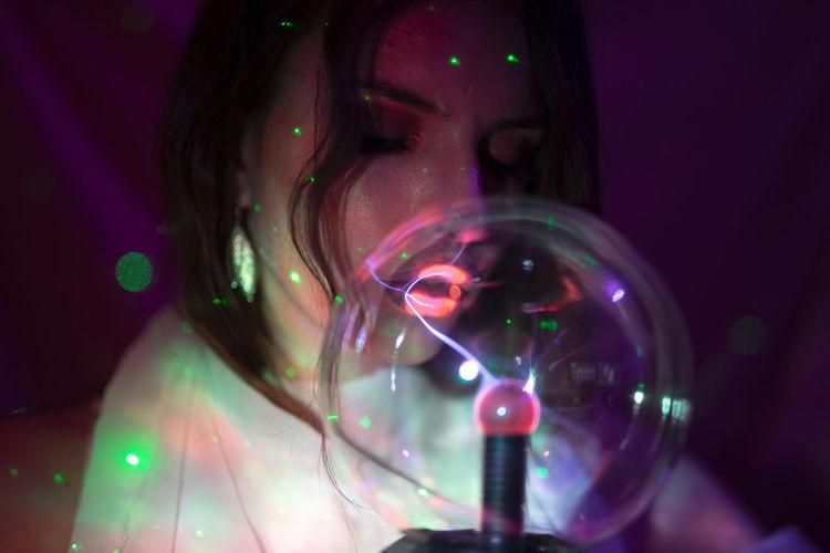 Close-up portrait of illuminated lighting equipment