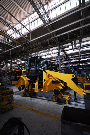 Giant heavy duty construction equipment assembly line. Bulldozer Construction Construction Machinery Dozer Heavy Duty Equipment Industrial Industrial Photography Assembly Line Factory Indoors  Industry Loader Machinery Manufacturing Equipment No Logo No Logos No People Nologo Technology Yellow