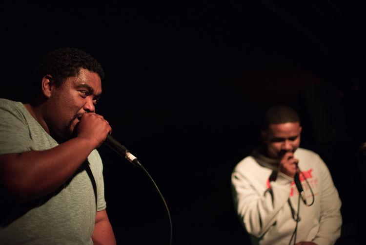 Singers Performing Against Black Background