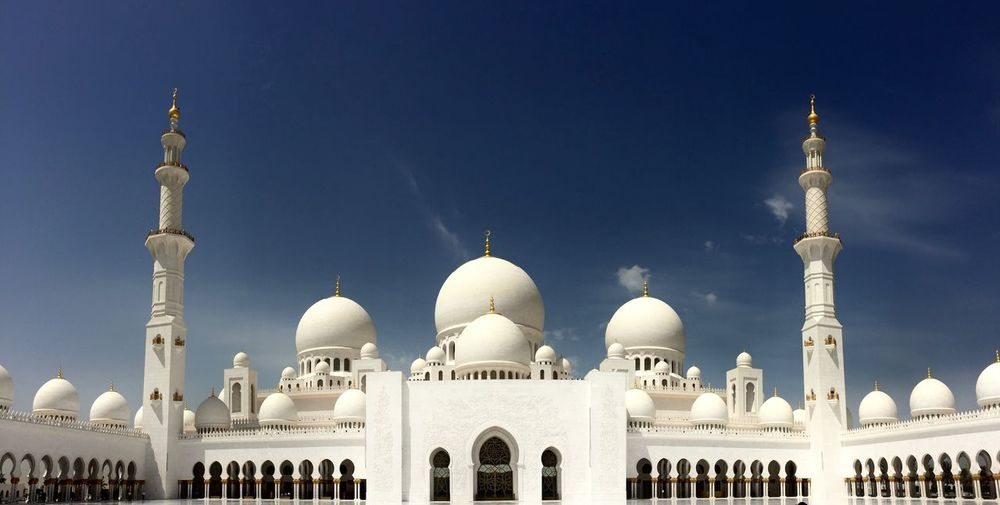 Low Angle View Of Mosque Against Blue Sky