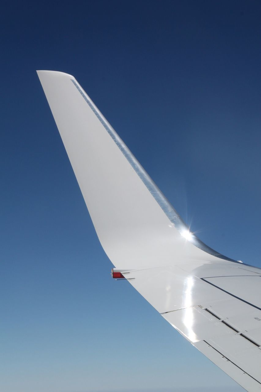 Airplane Wing Flying In Clear Blue Sky