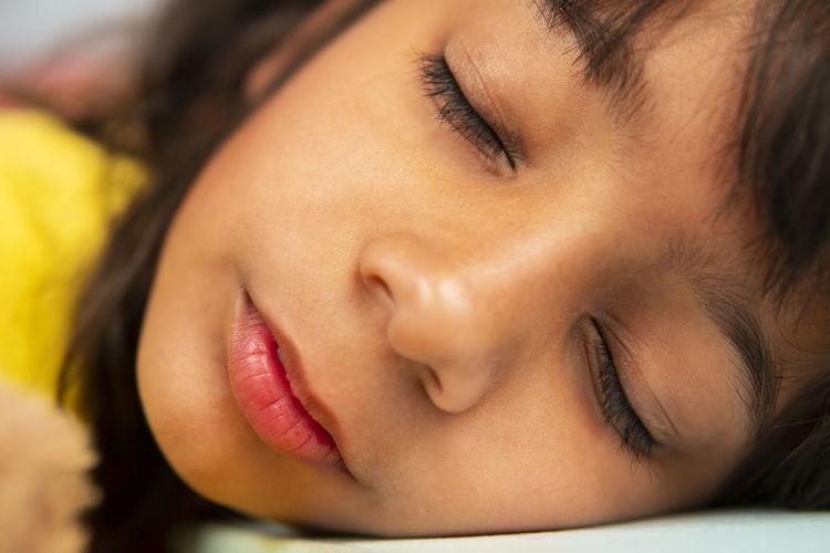 Close-up portrait of woman sleeping