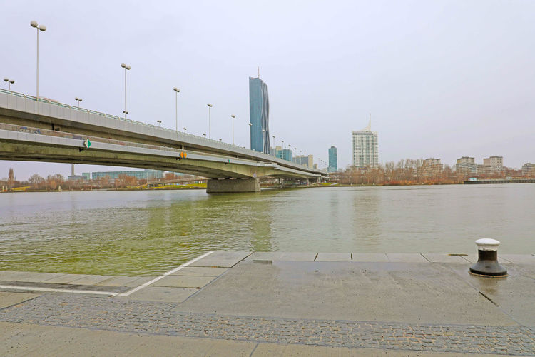 Danube with bridge in Vienna Architecture Built Structure Water Building Exterior Sky City Transportation Bridge Connection Bridge - Man Made Structure River Nature No People Skyscraper Office Building Exterior Building Day Outdoors Waterfront Cityscape Danube Danube River Danube Vienna Vienna Bridge Austria ❤