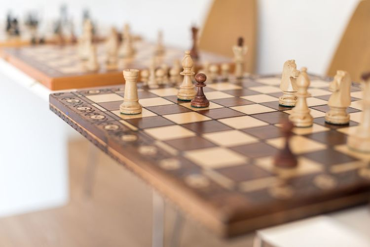 Close-up of chess board with pieces on table