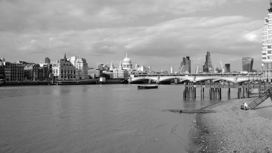 St paul cathedral by bridge over thames river in city