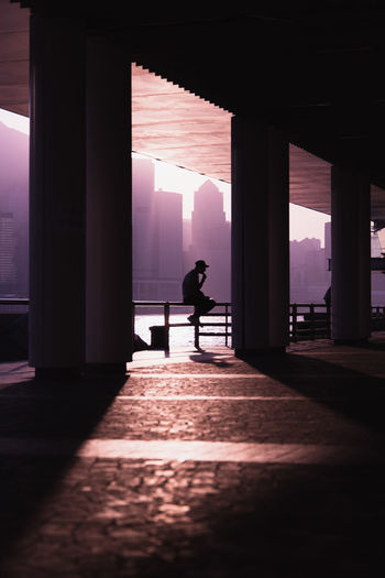 Silhouette man standing in corridor of building