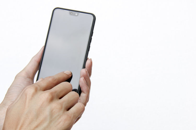 index finger touching mobile screen Blank Finger Human Finger Personal Perspective Body Part Mobile Phone Smart Phone Copy Space Portable Information Device Technology Communication Wireless Technology Human Hand Hand Human Body Part One Person Holding Connection Screen Studio Shot White Background Touch Screen