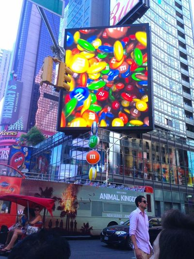 Times Square NYC Tall Buildings NYC Photography Urban Landscape Street Photography People Jammed Pack Cityscapes Enjoying Life Hello World Hanging Out Yum Yum Yum Candies Everwhere  Multi Colored Red Green Yellow Blue Fine Art Photography Colour Of Life