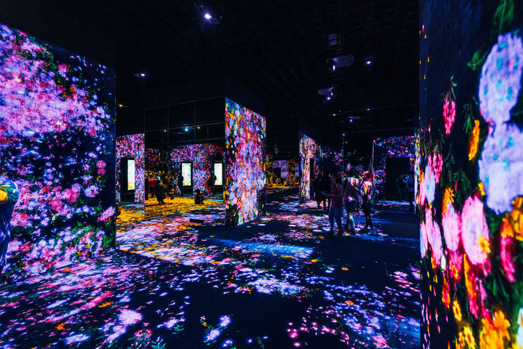 Illuminated Architecture Night Built Structure Lighting Equipment Building Building Exterior Incidental People Outdoors Real People Architectural Column Decoration City Celebration Unrecognizable Person Ceiling Glowing The Way Forward Nightlife TeamLabBorderless TeamLab