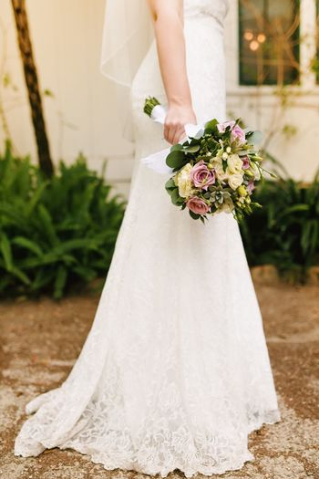 Wedding Ceremony Wedding Dress Bride Wedding Life Events Bouquet White Color Flower Focus On Foreground Celebration Women Holding Groom Real People Bridegroom Veil One Person Day Indoors  Close-up