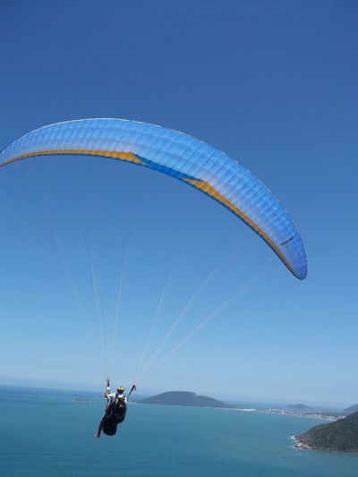 Paraglider Flying Over Islands In Sea