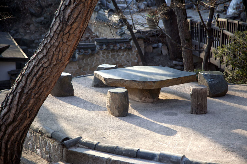 Absence Art Art And Craft Bench Composition Day Human Representation Leading Leisure Activity Lifestyles Narrow Old One Person Perspective Relaxation Ruined Sculpture Silsangsa Sitting Standing Statue Stone Take A Break The Way Forward Wood