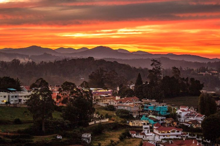 Dusk from the top of Ooty EyeEm EyeEm Best Shots Golden Hour Udhagamandalam Ooty Dusk Sunset Mountain Nature Scenics Beauty In Nature Mountain Range Sunset Tree Tranquil Scene Sky Tranquility Landscape Outdoors Building Exterior No People Built Structure Cloud - Sky Architecture