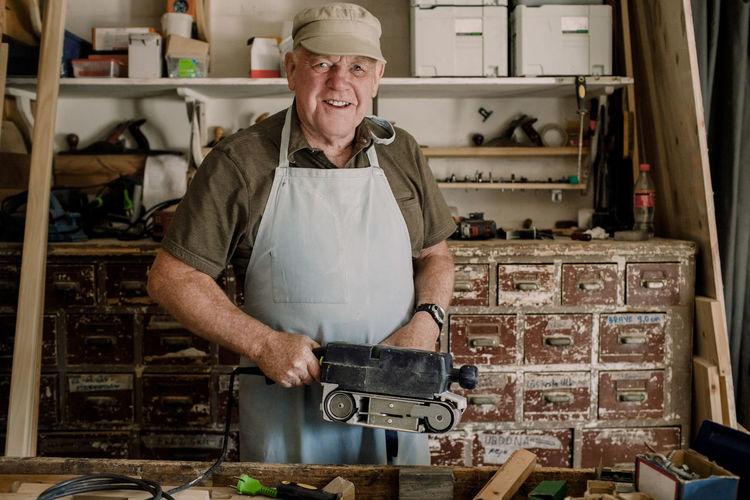Portrait of man standing in kitchen