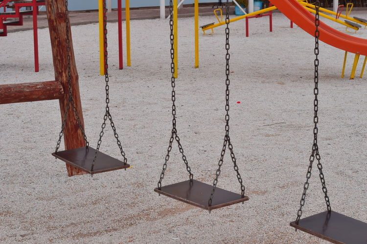 Empty swings at playground