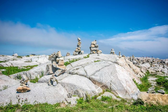 Beautiful day at Peggys Cove, Nova Scotia, Canada. Always a great tourist destination with its stunning views, gift shops, great food & music! Animal Themes Art Beauty In Nature Canada Cloud - Sky Day Halifax Inukshuk Inuksuk Mammal Nature No People Nova Scotia Outdoors Peggy's Cove Rock Rock - Object Sculpture Sculptures Sky Statue Tourism Tourist Tourist Attraction
