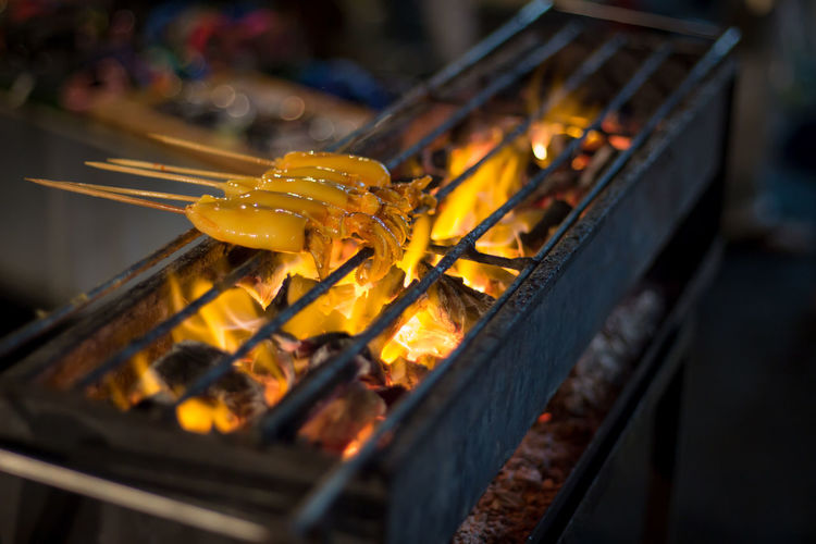 High angle view of seafood on barbecue grill
