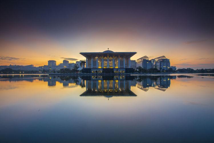 Tuanku Mizan Zainal Abidin Mosque In Lake During Sunset