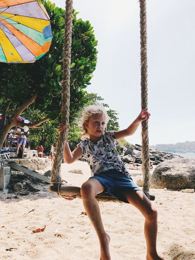 Full Length Leisure Activity Land One Person Real People Childhood Nature Lifestyles Beach Casual Clothing Child Day Tree Enjoyment Sunlight Plant Emotion Men Outdoors