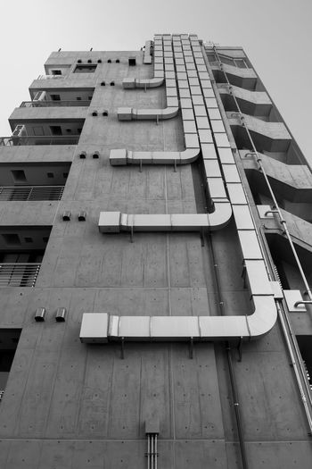 Ventilation duct on the side of the building in the city. black and white.
