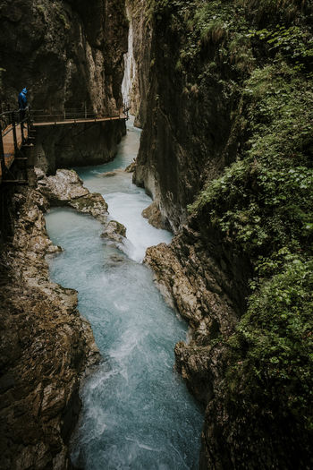 Water Beauty In Nature Scenics - Nature Rock Formation Flowing Water Outdoors River Street Leutaschklamm Adventure Travel Travel Destinations Bridge One Person Flowing Alps Motion Forest