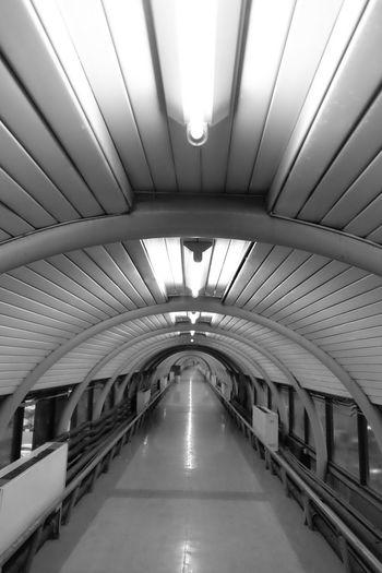 Long narrow footbridge with ceiling
